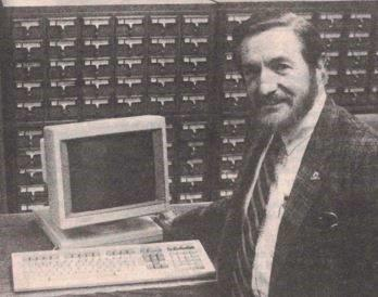 Frank Slater with a computer terminal in front of a card catalog